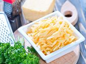foto of grating  - grated cheese in bowl and on a table - JPG
