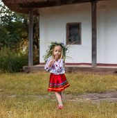 picture of national costume  - little girl in couronne from flowers in national costume - JPG