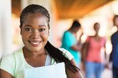 stock photo of cheer-up  - close up portrait of african university student on campus - JPG