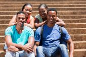 stock photo of afro  - happy young afro american college students on campus - JPG