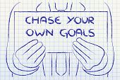 pic of chase  - Chase your goals sign in the hands of a business man - JPG