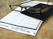 image of passbook  - Canada passport on declaration card with glasses and pen - JPG