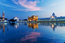 image of harmandir sahib  - Golden Temple (Harmandir Sahib also Darbar Sahib) in the evening at sunset. Amritsar. Punjab. India