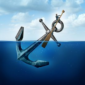 image of anchor  - Positive thinking and resilience business concept with a person on a floating anchor rowing with a paddle as a symbol of moving forward despite restrictions and challenges - JPG