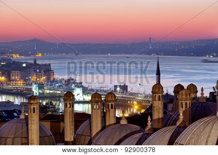 Domes Of Suleymaniye Mosque And The Bridge Through Bosphorus At Sunrise, Istanbul
