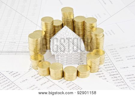 Pile Of Gold Coins Around House On Finance Account