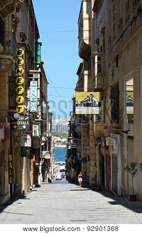 VALLETTA, MALTA - JAN 14, 2014: panoramic view of narrow street in Valletta, Malta
