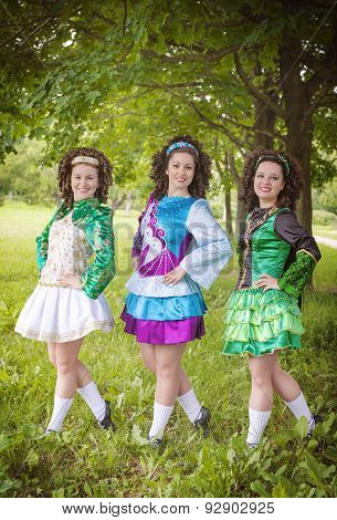 Three Young Beautiful Girls In Irish Dance Dress Posing Outdoor