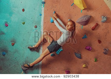 Sporty Little Girl Climbing Indoor