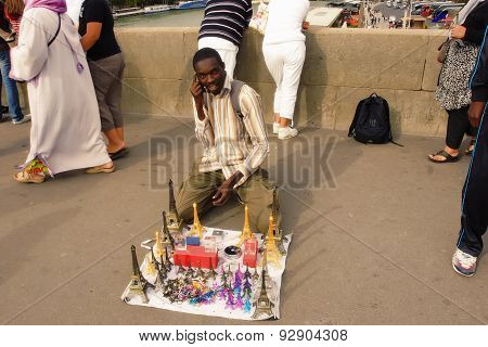 Paris, France August 18 2014. African Immigrant Offering Souvenirs On A Bridge Over The Seine.