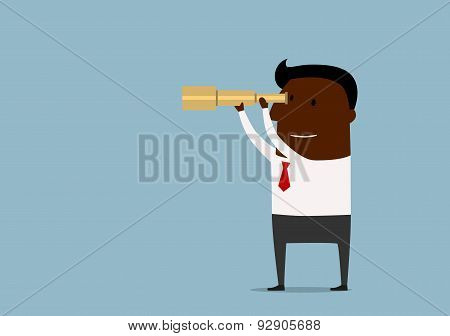 Businessman looking through a spyglass