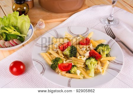 Pasta Penne With Broccoli, Tomatoes And Mozzarella Served On A Plate