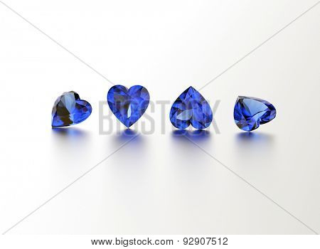Sapphire. Heart shape gemstone on  white. Jewelry background