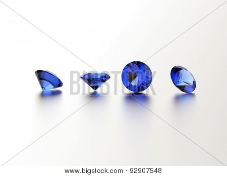 Sapphire. Round shape gemstone on  white. Jewelry background