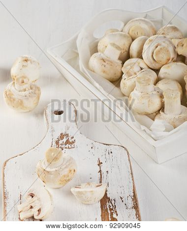 Fresh Whole White Button Mushrooms  On A Wooden Board.