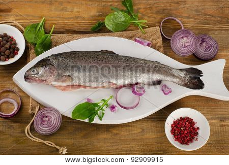 Raw Rainbow Trouts On A  White Cutting Board.
