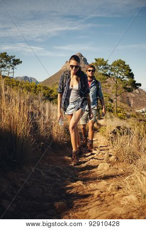 Hiker Couple Trekking Together In Countryside