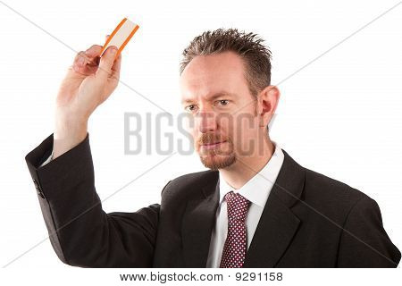 Businessman Holding A Ticket
