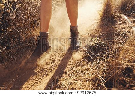 Young Woman Hiking On A Mountain Trail