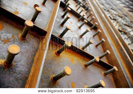 Big Bolts On A Steel Wall