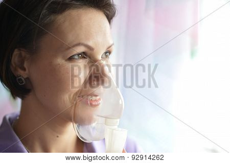 Young woman doing inhalation