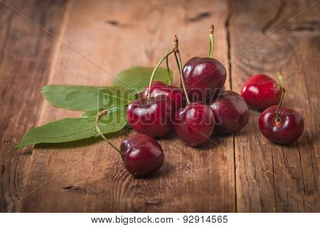 Sweet Cherries With Green Leaves