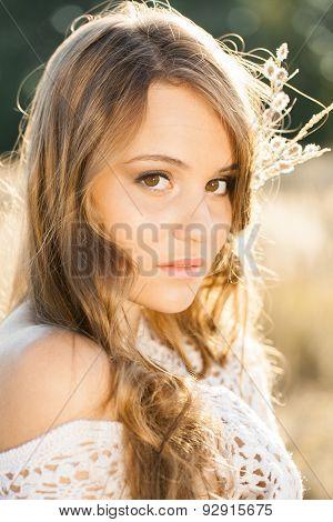 Portrait Of A Beautiful Model  In Open Field At Sunrise