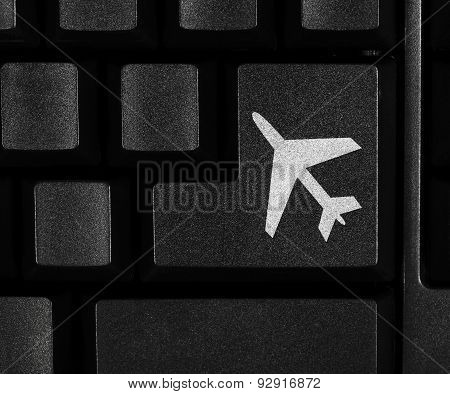 Aeroplane symbol on computer key