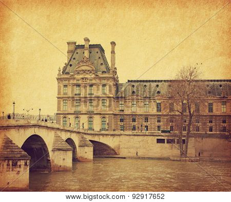Seine. Bridge Pont Royal in central Paris, France. Photo in retro style. Added paper texture. Toned image
