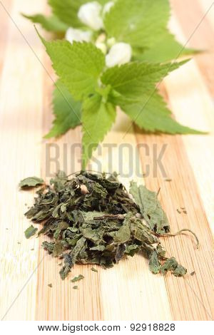 Heap Of Dried Nettle And Fresh Branch