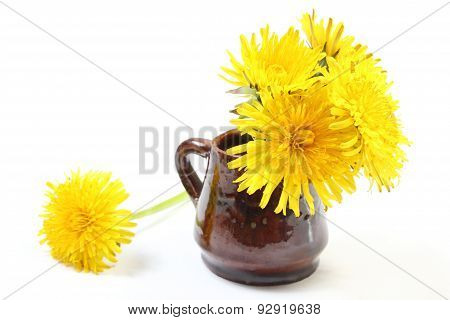 Yellow Flowers Of Dandelion In Brown Vase