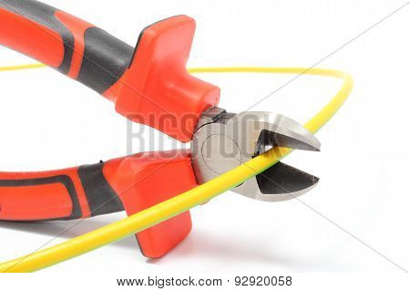 Metal Pliers And Green-yellow Cable On White Background