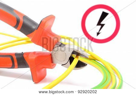 Metal Pliers, Green-yellow Cable And High Voltage Danger Sign