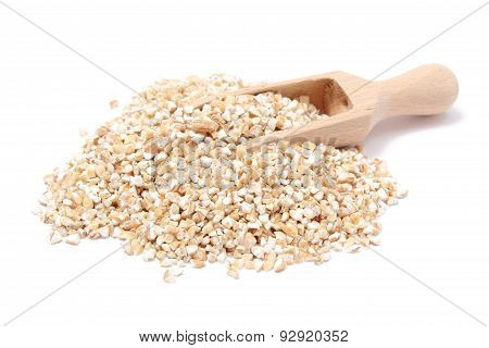 Barley Groats With Wooden Spoon Isolated On White Background