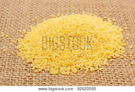 Heap Of Millet Groats On Jute Canvas