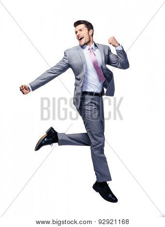 Happy handsome businessman running over white background and looking away