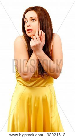 Frightened Woman In Yellow Dress Keeps Hands On Face