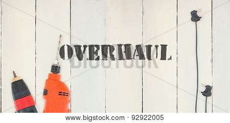 The word overhaul against diy tools on wooden background