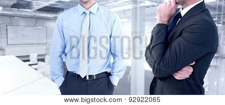 Frowning businessman thinking against classroom