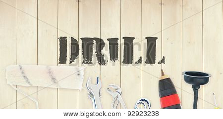 The word drill against diy tools on wooden background