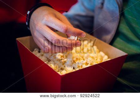 Man eating popcorn at the cinema