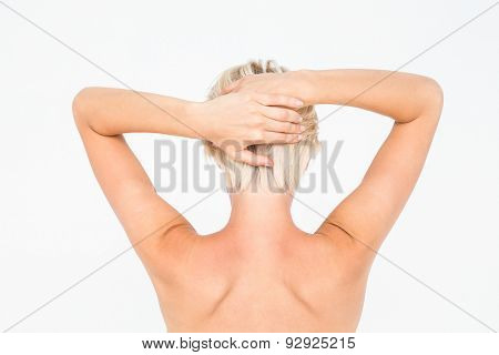 Beautiful topless woman touching her hair on white background