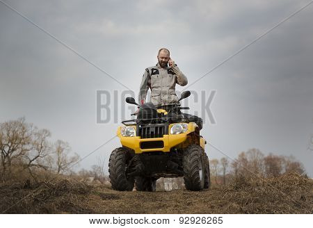 Atv Driver Talking On The Phone While Driving