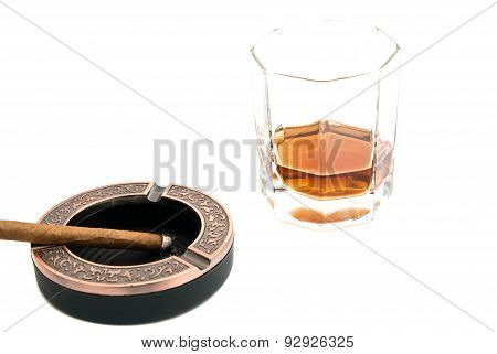 Cigarillo In Ashtray And Whiskey On White