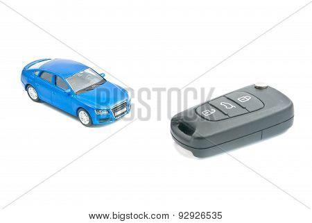 Car Keys And Blue Car On White