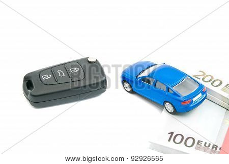 Car Keys, Blue Car And Euro Banknotes