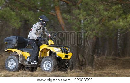 Man Riding Dirty 4X4 Atv Quad Bike