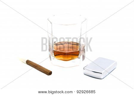Cigarillo, Lighter And Glass Of Cognac