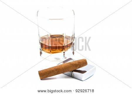 Cigar, Glass Of Cognac And Lighter On White