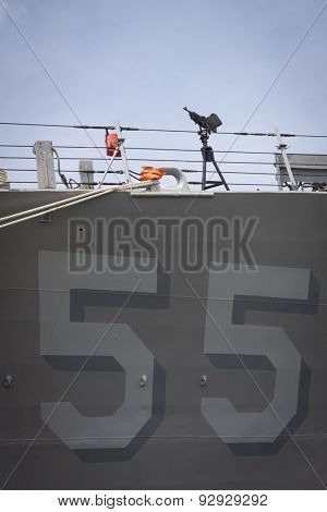 STATEN ISLAND, NY - MAY 20 2015: Low angle view of number 55 painted on the hull of the USS Stout (DDG 55) guided-missile destroyer while moored for Fleet Week NY 2015 at Sullivans Pier.